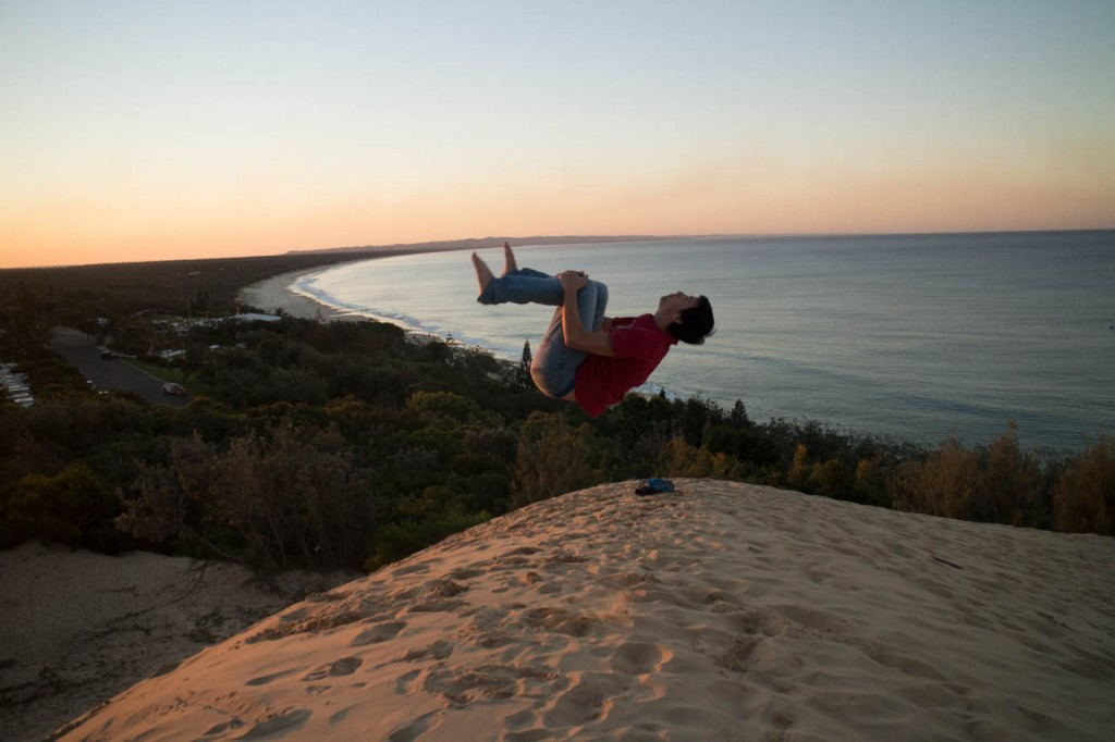 Le me doing a backflip on a dune in the most boring town on the east coat. People only go to Rainbow beach for a Fraser island trip.